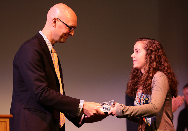 Paige Beede '16 recieving an award from Head of School Dan Scheibe  during Cum Laude Day in the RMPAC.